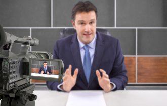 tv studio camera recording male reporter or anchorman
